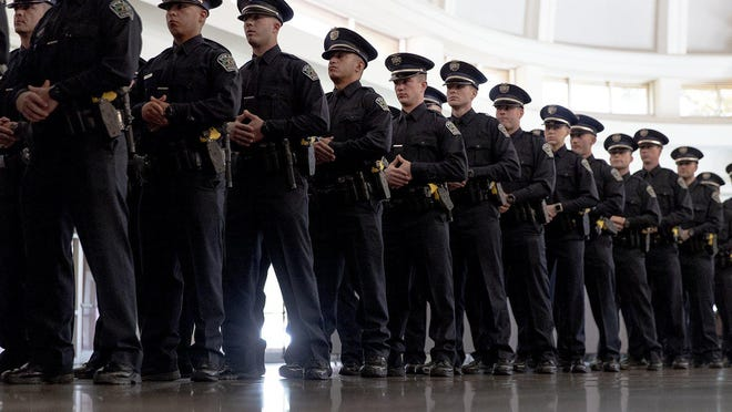 Austin police cadets are shown in January waiting for the start of their graduation ceremony.