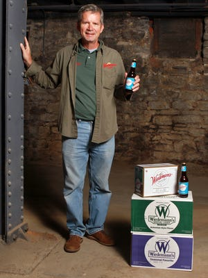 Wiedemann Brewing Co. co-owner Jon Newberry stands in the basement of the WaterTower Square Building in Newport, where the company plans to open a tap room/beer garden and brew beer on site. The fermentation tanks will be located in this area of the building, which dates back to the 1860s.