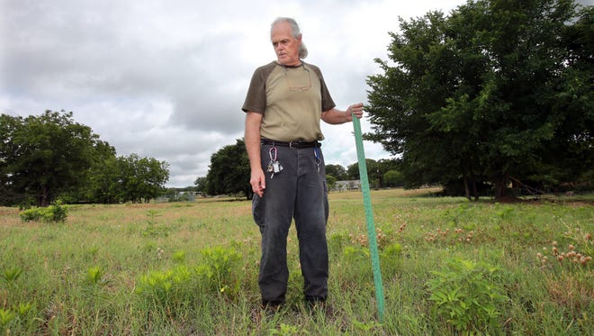 David Hull stands on the area of his property that is thought to be the epicenter of a recent earthquake in Reno, Texas.  The ground, once flat, has small rolls and changes in height.  Hull blames a nearby fracking well.
