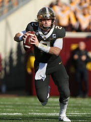 Minnesota quarterback Tanner Morgan (2) runs the ball during a game against Maryland on Oct. 26, 2019, in Minneapolis.