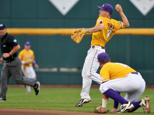 LSU shortstop Alex Bregman (8) throws out TCU's Derek Odell at first base, as LSU second baseman Jared Foster, foreground, stays out of the way during the fourth inning of an NCAA College World Series baseball elimination game in Omaha, Neb., Thursday, June 18, 2015. (AP Photo/Ted Kirk)
