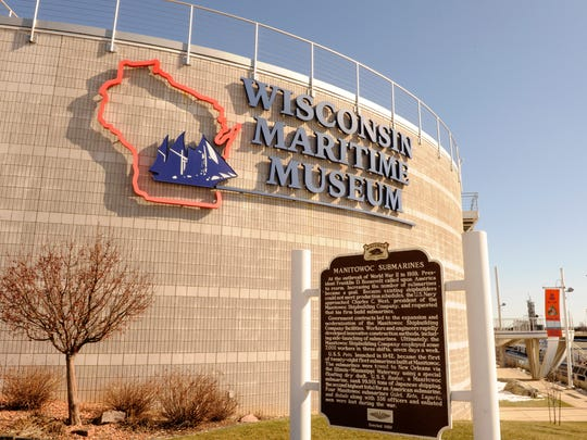The Wisconsin historical official marker sign recognizing the submarines built in Manitowoc during WWII outside the Wisconsin Maritime Museum.