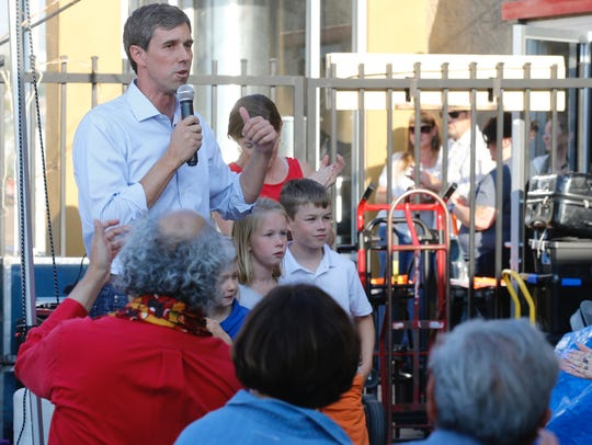 Congressman Beto O'Rourke shares a beer with Ode Brewery