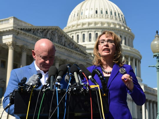Former congresswoman Gabrielle Giffords, standing with