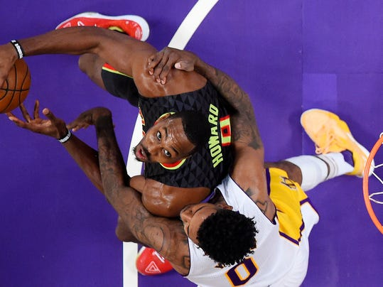 Atlanta Hawks center Dwight Howard, left, shoots as Los Angeles Lakers guard Nick Young defends during the second half of an NBA basketball game, Sunday, Nov. 27, 2016, in Los Angeles. The Lakers won 109-94. (AP Photo/Mark J. Terrill)
