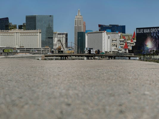 File - In this Tuesday, March 28, 2017, file photo, a patch of land that has been named as a possible site for a Raiders football stadium sits empty near the Las Vegas Strip in Las Vegas. Taxpayers contributed over $4.6 million for an NFL stadium in Las Vegas during March, when an increase on area hotel taxes went into effect to cover the state's share of the project. (AP Photo/John Locher, File)