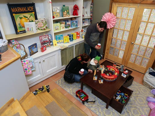 Dan and Lili Griffith and son Wes from Mount Kisco browse the children's area in Scattered Books in Chappaqua.