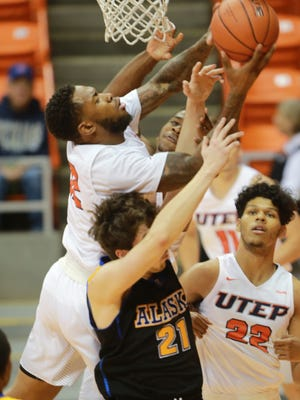UTEP's Terry Winn, top left, grabs a rebound over Alaska-Fairbanks' Zach Pederson on Saturday at the Don Haskins Center. UTEP's Paul Thomas is at right.