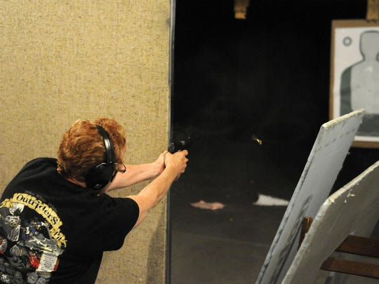 Deb, an Oak Harbor resident and member of the Oak Harbor Conservation Club, shoots during a women's only shooting class at the club on Monday night.