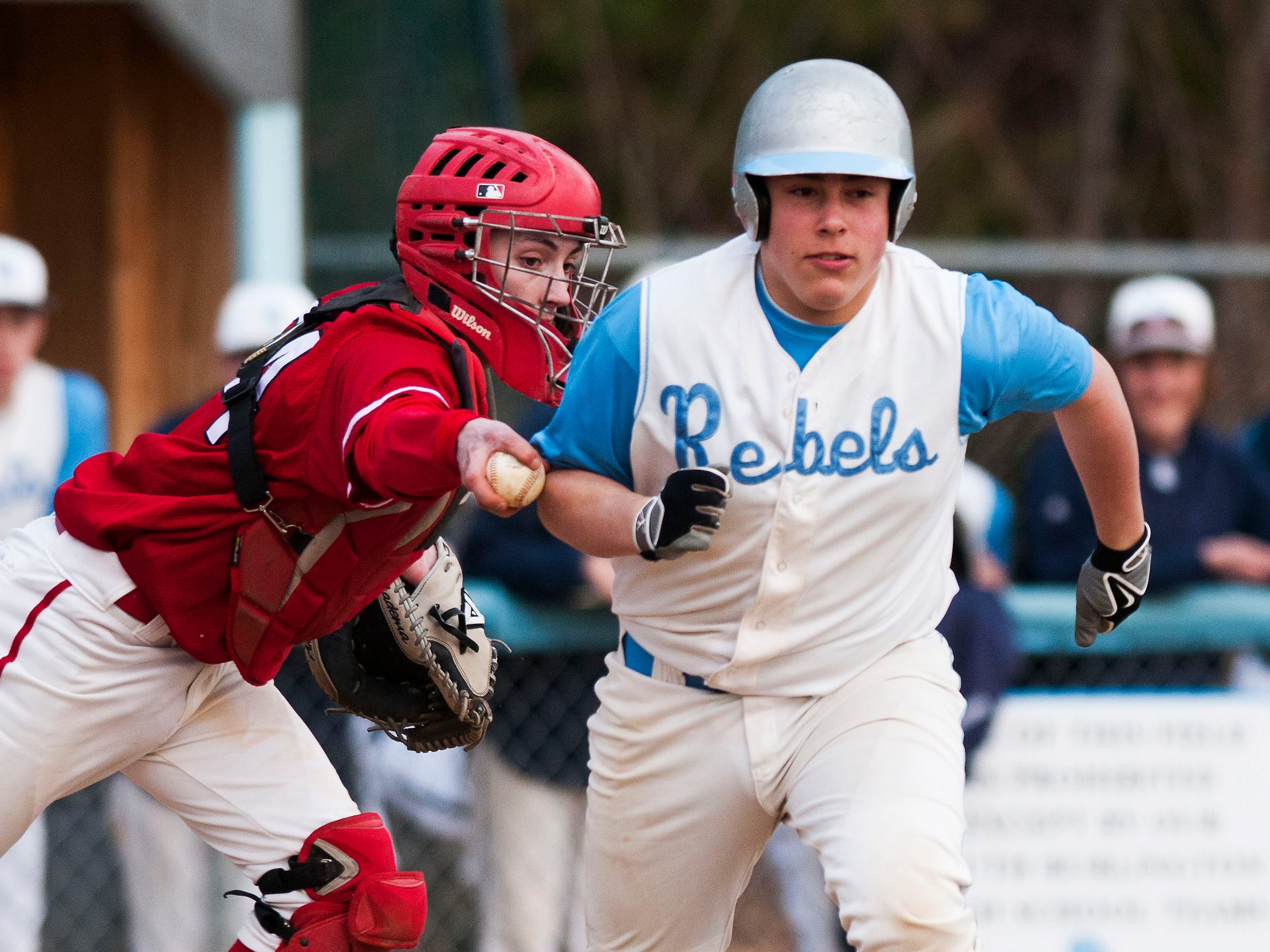 CVU catcher Dan Poodiack (24) tags out South Burlington's Steven Levite (22) during the boys baseball game between the Champlain Valley Union Redhawks and the South Burlington Rebels at Dorset park on Thursday afternoon April 16, 2015 in South Burlington, Vermont. (BRIAN JENKINS, for the Free Press)