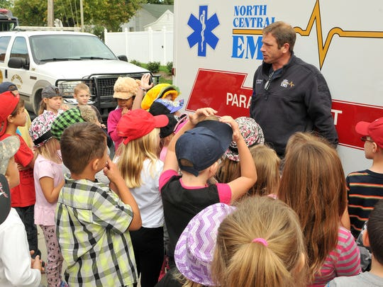 North Central EMS paramedic Kevin Peloquin talks to students at Bataan Elementary about safety on Thursday afternoon.