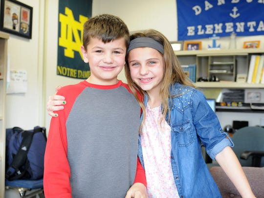 Fraternal twins Cameron and Claudia Gillum, 10, are fourth graders and one of 10 sets of twins at Danbury.