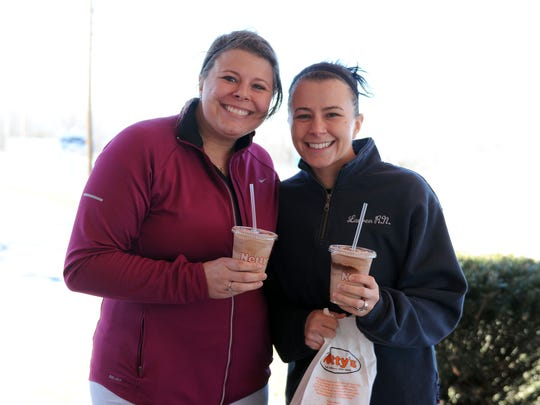 Jessica Ripley, of Huron, and Lauren Kwasny, of Vermillion, were all smiles after buying chili dogs at Netty's in Marblehead on Monday afternoon. Netty's opened for the season on Friday, and is open seven days a week from 11 a.m. until 8 p.m.