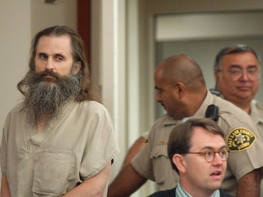 Brian David Mitchell, who was later convicted in the kidnapping of Elizabeth Smart, enters the courtroom for his arraignment on Sept. 2, 2004, at the Matheson Courthouse in Salt Lake City, Utah. He pleaded not guilty to kidnapping and other charges in the knifepoint abduction of Smart.