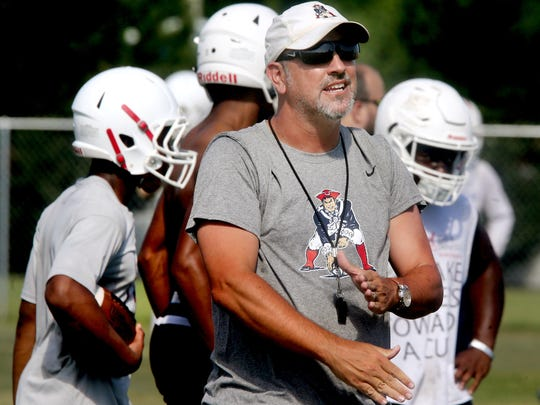 Oakland head football Coach Kevin Creasy directs players during the team's practice at the school, on Tuesday, June 14, 2017, in Murfreesboro, Tenn.
