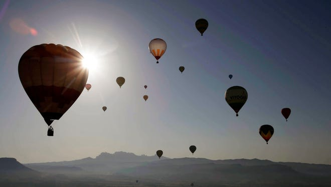 Hot air balloons fly during the 20th European Balloon Festival in Barcelona, on July 7, 2016.