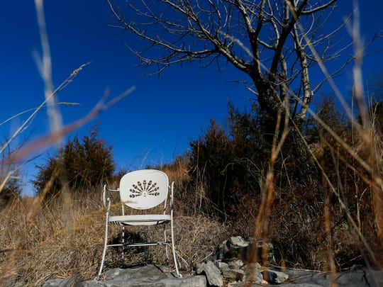 A lone chair sits on a hill overlooking the 1,011-acre