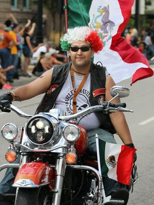 A Harley-Davidson rider flying the flag of Mexico had hair to match during the Harley-Davidson 110th Anniversary Parade on Aug. 31, 2013.