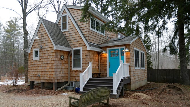 Karen and Bill Dredge's rural Mequon home, now 1100 square feet, was originally a tiny Sears Roebuck kit home.