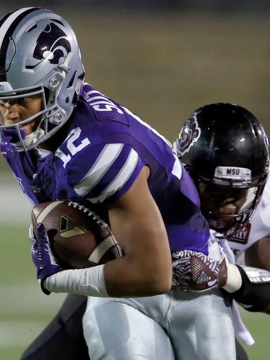 FILE - In this Sept. 24, 2016, file photo, Kansas State wide receiver Corey Sutton (12) is tackled by Missouri State cornerback Matt Rush during the first half of an NCAA college football game in Manhattan, Kan. Kansas State coach Bill Snyder is defending his choice not to grant a wide receiver a release from his scholarship, a decision that has sparked controversy around his program. Corey Sutton announced his desire to transfer, claiming Snyder did not follow through on certain promises of playing time. Snyder said Thursday night, June 1, 2017, that his view is that players make a commitment to the program when they sign a national letter of intent, just as the program makes a commitment to them with a scholarship. (AP Photo/Orlin Wagner, File)