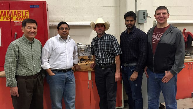 Faculty, staff and students in New Mexico State University's Civil Engineering and Manufacturing Technology & Engineering Center have collaborated on an earthquake research project. Yu-Ping Tang, from left, engineer, Tathagata Ray, assistant professor, Charlie Park, M-TEC manager, Jame Alexander, structural engineering Ph.D. student, and Matthew Dorsey, M-TEC junior, are shown with the self-centering prototype.