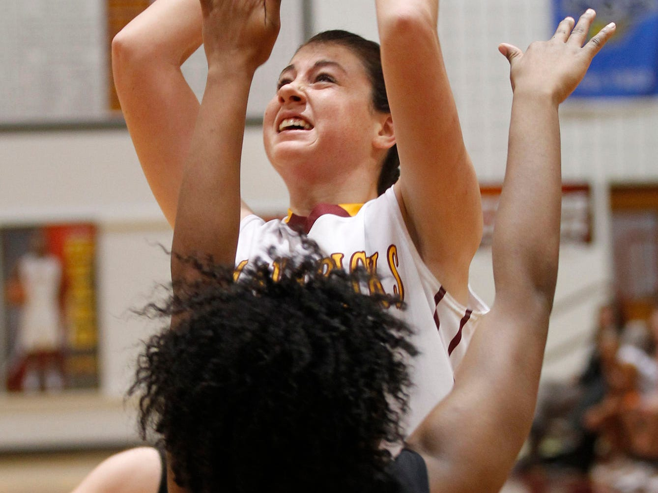 McCutcheon's Becca Spitalniak puts up a shoot over Alexia Randolph of Lafayette Jeff in girls sectional basketball action Friday, February 13, 2015, at McCutcheon High School. McCutcheon defeated Lafayette Jeff 43-33.