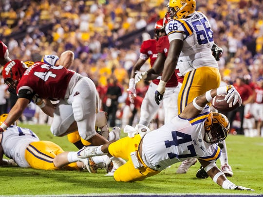 LSU Tigers fullback Bry'Kiethon Mouton (47) tries to put the ball in the end zone during the second half of Saturday's game against Jacksonville State.