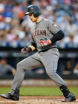 Arizona Diamondbacks' Brandon Drury crosses the plate on his second-inning solo home run off New York Mets starting pitcher Steven Matz in a baseball game, Tuesday, Aug. 9, 2016, in New York.