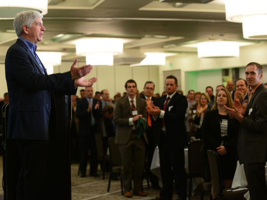 Gov. Rick Snyder received a standing ovation from an audience of 500 Thursday at the Lansing Regional Chamber Economic Club luncheon in East Lansing.