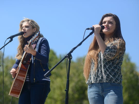 Sisters Payton and Taryn Taylor perform in Gallatin at an event to benefit the Edison School and the Sumner Teen Center.