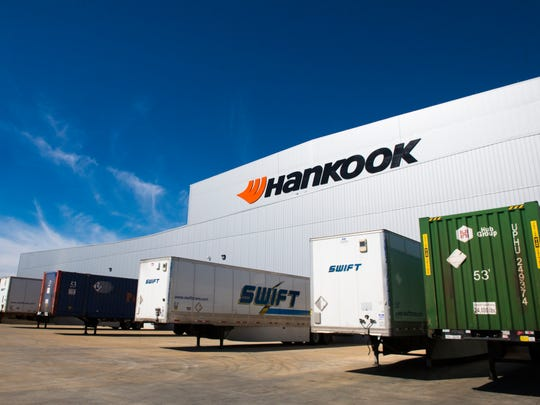Trucks outside of Hankook's tire inventory building. The building can hold up to a capacity of 350,000 tires.
