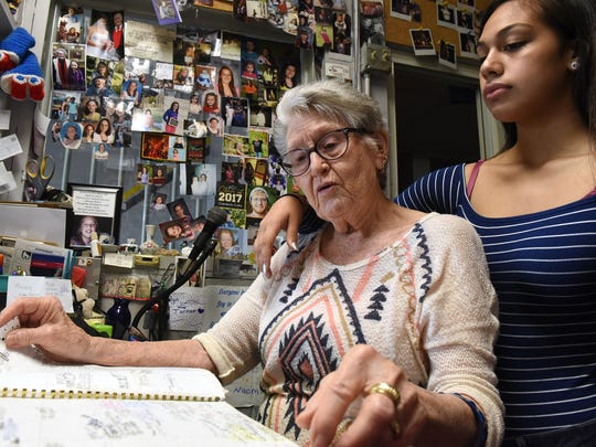 Naomi Griffith with her great-granddaughter Makaeleah Bering in the front office of the Roll-A-Way Skating Center on Church Street in Newark. The office is decorated with photos of generations for employees and customers. Naomi's father-in-law, Virgil Griffith built the business in 1954. Naomi and her husband, Elton, both work together at the business.
