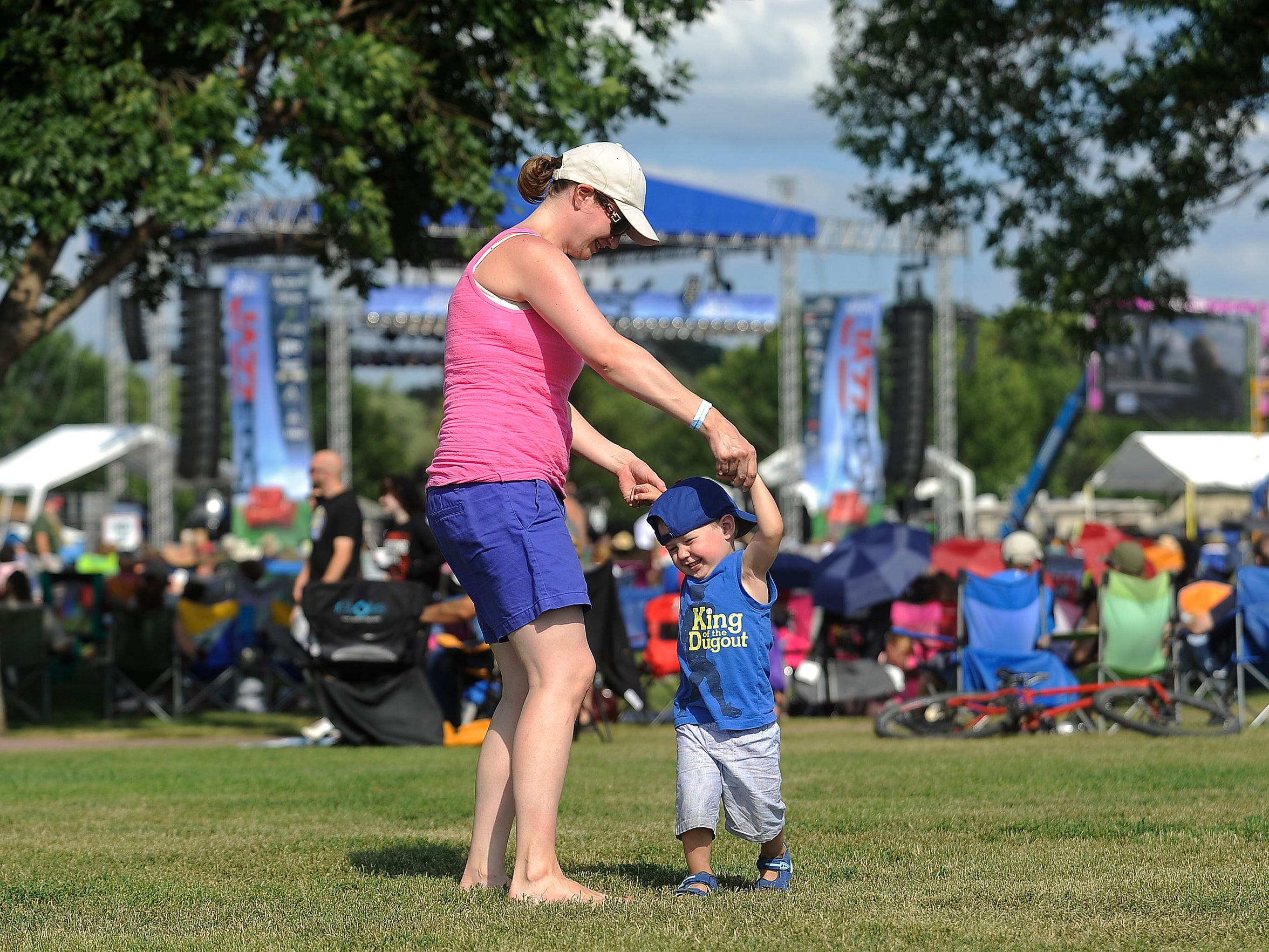 Nicole Chapman dances with her son Timmy, 2, while Slim Man performs during last year's Jazz Fest.