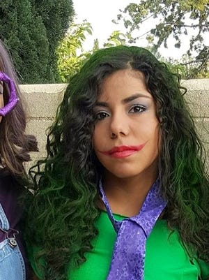 From left, Gabby Ray Perez, Mireya Trujillo and Mariela Giron get into the spirit of Wildcat Week for Tuesday's Heroes or Villains dress-up day on Tuesday.
