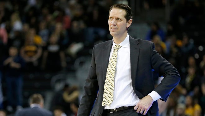 Northern Kentucky Norse head coach John Brannen reacts to a foul on his defense in the second half of the NCAA Horizon League basketball game between the Northern Kentucky Norse and the Green Bay Phoenix at BB&T Arena in Highland Heights, Ky., on Saturday, Feb. 10, 2018. The Norse took an 86-80 win over Green Bay.