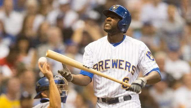 Lorenzo Cain of the Brewers isn't pleased with himself after he struck out chasing a pitch out of the strike zone with runners on first and second in the bottom of the fifth inning against the Dodgers on Friday night.