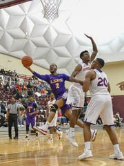 LSUS Guard D.J. Clayton drives past the Northwestern defense in the Gold Dome.