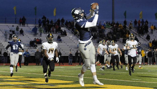 Pittsford's Kevin Ryan catches a touchdown pass to put the Panthers up 28-27 over McQuiad during a Section V Class AA semifinal played at SUNY Brockport, Saturday, Oct. 28, 2017. No. 1 seed Pittsford scored 35 unanswered points to advanced to the Class AA final with 35-27 win over No. 5 seed McQuaid.