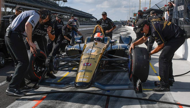 Schmidt Peterson Motorsports IndyCar driver James Hinchcliffe (5) sits in his car as he crew attempts to fix the vibration in his car in the finals minutes qualification day for the Indianapolis 500 at the Indianapolis Motor Speedway on Saturday, May 19, 2018.