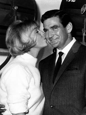 """Rod Taylor celebrates his 35th birthday on the set of """"Do Not Disturb,"""" and gets a big birthday kiss from co-star Doris Day on Jan. 14, 1965."""