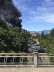 In this photo provided by Silas Bleakley, oil tank cars are derailed Friday near Mosier. The accident happened just after noon in the Columbia River Gorge about 70 miles east of Portland.