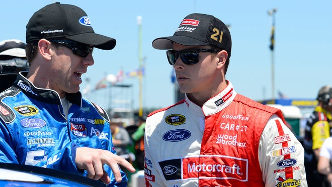 Trevor Bayne, right, and Carl Edwards talk during qualifying at Talladega Superspeedway on May 3.