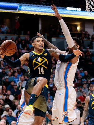 Feb 1, 2018; Denver, CO, USA; Oklahoma City Thunder forward Paul George (13) defends against Denver Nuggets guard Gary Harris (14) in the second quarter at the Pepsi Center.