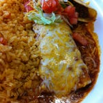 The taco and enchilada plate at Tres Amigos is accompanied by rice that was excellent: fluffy and fresh.
