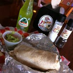 This ground beef burrito with brown rice, roasted corn salsa, tomatoes, black olives, cheese and sour cream at Rock the Guac in Cocoa Beach was washed down with a bottle of Jarritos limon.