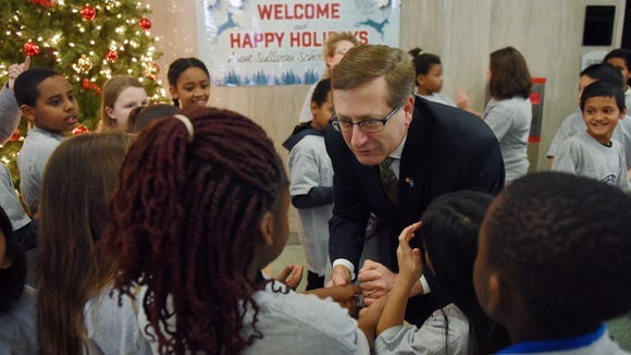 Sioux Falls mayor Mike Huether greets students at City Hall in downtown Sioux Falls during the 2016 Annual Holiday Music Program.