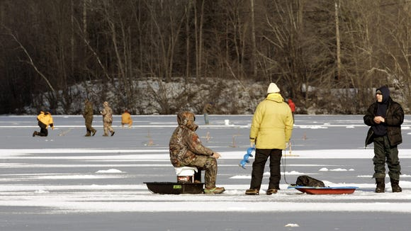 In this file photo, ice fishermen flock to the Muscoot