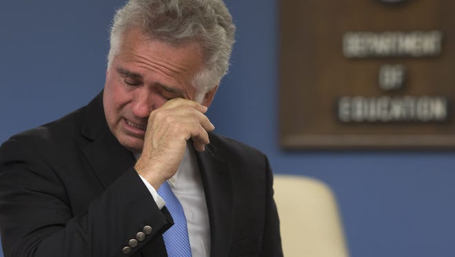 Arizona's public schools chief John Huppenthal breaks down in tears, June 25, 2014, during a press conference at the Department of Education, 1535 W. Jefferson Street, Phoenix.