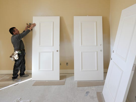 Carpenter Fred Armendariz fits doors for the Fisher House as the facility undergoes a face-lift.