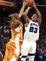Memphis guard Derrick Rose (23) shoots over the reach of Tennessee's J. P. Prince, left, in the first half of a college basketball game in Memphis, Tenn., Saturday, Feb. 23, 2008. Rose led Memphis with 23 point but the top-ranked Memphis Tigers lost to Tennessee 66-62.